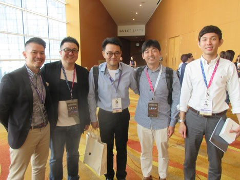 CJ E&M Korea: Hwang Jin Woo, manager, head of formats, and Jan Ho Seo, general manager, and Ryan Kim, acquisitions, surrounded by Linfield Ng, format